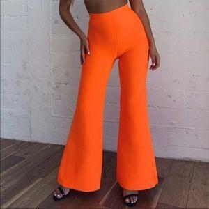 Neon orange flare pants